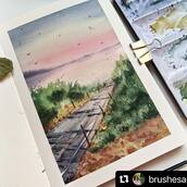 """#Repost @brushesandlens with @make_repost ・・・ """"An Evening Walk"""" Painting #4 in the collection 'A Quiet Path' . . Sometime back, i had posted a smaller version of the same painting in my stories. It was a beautiful glowing morning at the beach and i loved all the yellows and pinks in the sky.  . At the same spot, during the evening time, post sunset, there were again these beautiful pinks and yellows but also there was a hint of blues and purples. I took this as an inspiration to paint this painting.  . I hope it gives you the sense of calm that I felt when i was there. . . Sketchbook @kovalsketchbooks  . . #sunsetpainting #eveningpainting #watercolorPainting #watercolourpainting #sketchbookpainting #watercolors #potpourriofartists #drawing_pigments #soulful_artists #watercolor_daily #aquarelle_cafe #aquietpath #aquarellegallery #aquarelle_daily #the_creative_ladder #artists_hidden #watercolorart #beach #beachpainting #watercolorpaintings #creativityexplode #paintingcollection #painting_dreams"""